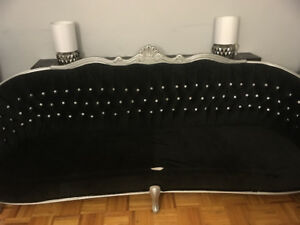 black velvet tufted vintage couch