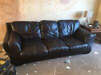 Dark brown three seater sofa
