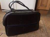Vintage leather bag and selection of eight tracks