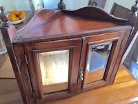 A late Victorian mahagon corner cupboard with built in mirrors on both glass doors!