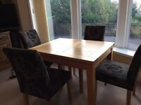 Solid oak dining table & 4 cloth chairs.