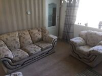 Three piece suite sofa and chairs