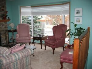 PAIR OF SKLAR PEPLAR WINGED BACK CHAIRS AND OTTOMAN