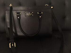 Fairly new leather Kate Spade fashionable cross body/hand bag