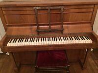 Free Godfrey piano and stool -free to good home