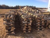 Unseasoned maple firewood for picking up