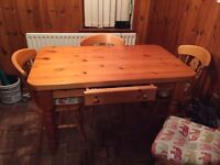 Pine table and four chairs (without seat cushions)