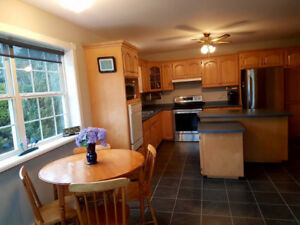 Home and steel garage in Beaver Bank for sale.