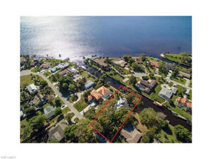 REDUCED 25K***Custom Built Waterfront POOL Home
