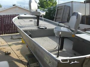 NOW HERES A NICE 14 FT ALLUM. BOAT--MOTOR--TRAILER