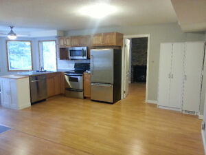 TWO BEDROOM SELF CONTAINED WALKOUT WITH OWN LAUNDRY AND GARAGE!!