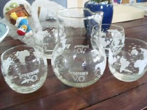 vintage seagrams VO decanter and glasses worlds map