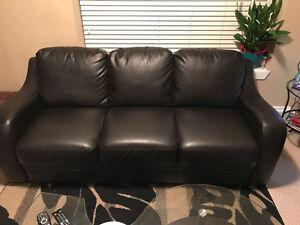 Black faux leather sofa