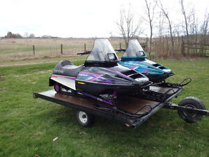 Low mileage pair of Polaris Indy Lite & Deluxe 340s with trailer