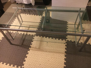 Tv table heavy sturdy glass. Excellent condition not scratched
