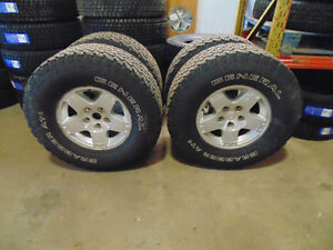 $900 SET OF 4 USED RIMS AND TIRES FOR YOUR DODGE RAM !!!