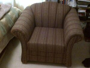 New upholstered club chair.