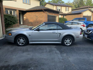 For sale: 1999 ragtop Ford Mustang $3,500.00