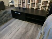 Gorgeous black lkea entertainment cabinet with lights and glass shelf.