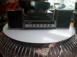 Magnasonic AM/FM stereo and record player with speakers-$65
