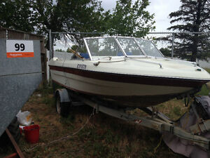 Lower price!! 16 Foot Boat with 65 hp mercury motor and trailer