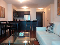 Downtown Corporate Modern 1 Bed+Den Suite, Financial District