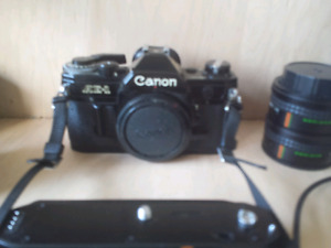 Canon AE1 camera  BLACK and bag full of accessories