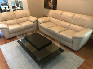 Beige leather living room set with coffee table