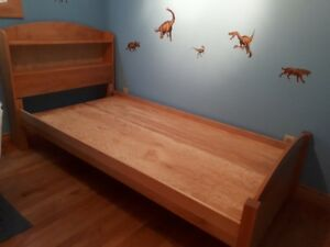 Kids wooden twin bed with bookcase headboard