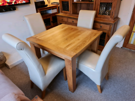 Chunky solid oak dining table and 4 chairs(can be sold separately)