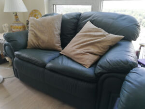 Green leather loveseat/sofa in LIKE NEW condition