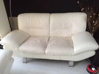 Two modern white cream leather settee sofas day bed