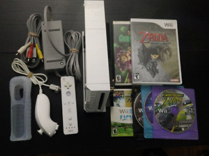Wii System complete with hook ups and 6 games.