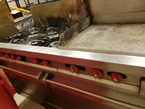 Commercial six burner gas stove with flat griddle