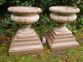 Match pair of stone urns on large heavy bases