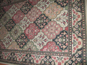 AREA RUG 88 INCHES LONG 62 INCHES WIDE