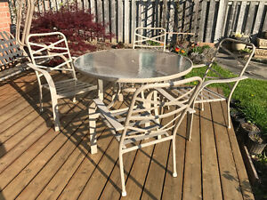 Must sell - Patio table with 4 matching chairs & umbrella base