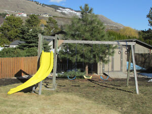 Swing set with curved slide and tower