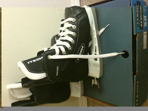 For sale hockey skates- size Youth 5. Brand new.
