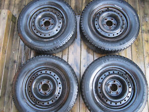205/65R15 Michelins. 4 winter and 4 summer on steel rims w caps. Kitchener / Waterloo Kitchener Area image 2