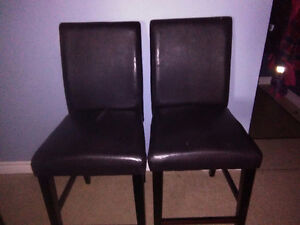 Bar height faux leather chairs