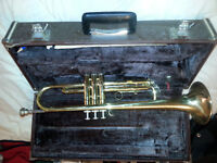 yamaha truphet with case and song books.