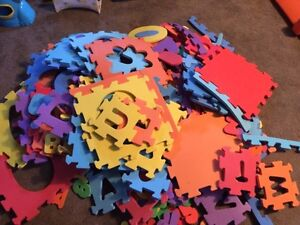 Large pile of foam mats and letters