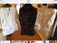 Multiple women's winter jackets 4 of them leather.