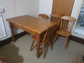 Table and 4 chairs. Solid wood