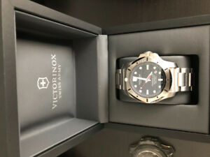 Victorinox INOX 200 meter stainless steel dive watch.