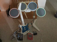 rockband drum and guitar with 2 games