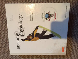 Anatomy and Physiology textbook with atlas of human body