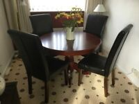 Wooden dining table and 4 chairs - £75
