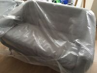 Designer 2 seater sofa (brand new in wrapping)